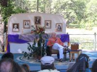 Swami Kriyananda giving a talk at the amphitheater