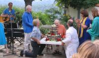 Swami Kriyananda enjoying the view of the birthday cake