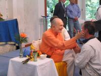 Swamiji joyfully blessing a guest