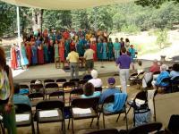 Choir rehearsing before Swami's talk