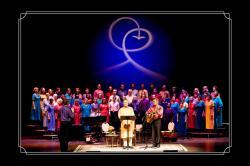 Swamiji on stage singing Peace