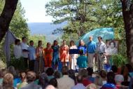 Young people singing on an outdoor stage