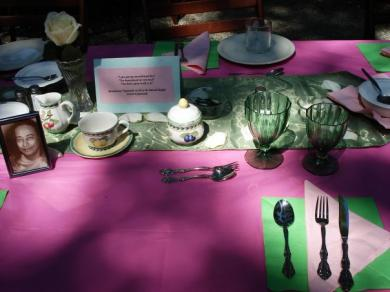 A beautifully arrayed table setting in magenta and green, with nice silverware