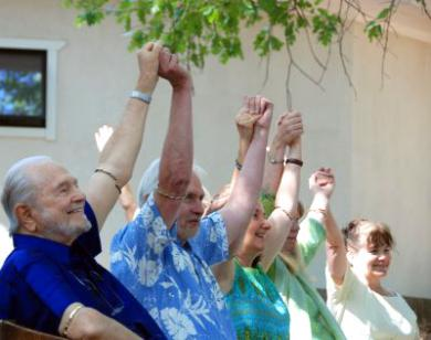 Swami Kriyananda, Jyotish and Devi Novak, Nischala, the co-director of Ananda's Institute of Alternative living, and another Ananda member raising their hands at the end of 'Many Hands Make a Miracle.' Many thanks to Tim and Lisa Clark, Melody West, and others for these beautiful photos.