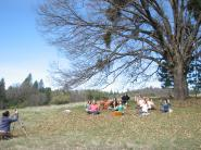 Melody taking a photo of everyone meditating under a tree
