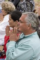 audience_being_led_in_prayer__with_tim_and_lisa_clark.jpg